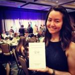 Lauren Jessen holding Congresiional Award medalist book