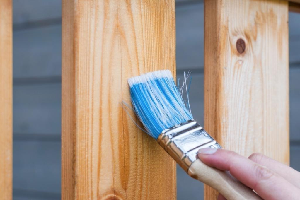 Applying varnish on wooden plank